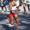 BRYAN EATON/Staff photo. Emily Durkin breaks a course record for a female runner in the April Fools Race.