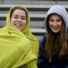 JIM VAIKNORAS/Staff photo Newburyport high juniors, Grace Shelley and Skylar Snider bundled up to watch Newburyport host Central Catholic Thursday at World War Memorial Stadium in Newburyport.
