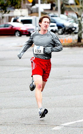 JIM VAIKNORAS/Staff photo Dan O'Flynn wins the Spring into Spring 5K in Rowley Saturday morning.