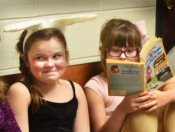 BRYAN EATON/Staff photo. Lilly Stevens, left, and Skylar Griffith, both 8, await their appearing in the Bunny Fashion Show at Amesbury Elementary School during dress reheasal. The second-graders wrote different spring-related stories that they performed today and Thursday for their parents.