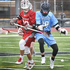 BRYAN EATON/Staff photo. Triton's #19 loses his stick in a collision with a Wakefield player.