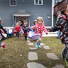 BRYAN EATON/Staff photo. Baskets in hand, youngsters from Little Inspirations Daycare in Salisbury head out for their annual Easter Egg Hunt on Thursday afternoon. After the gathering of the eggs, they got a visit from the Easter Bunny and were treated to ice cream.