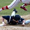 JIM VAIKNORAS/Staff photo  Triton's Tommy Lapham dives back to first under Masconomet's Dash Crevosierat during their game at Masconomet Tuesday.