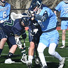 BRYAN EATON/Staff photo. Triton's Jack Diska battles for the ball.