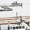 BRYAN EATON/Staff photo. Despite the snow spitting on Monday morning, a crew from Ring's Island Marina in Salisbury started setting docks in the Merrimack River as spring slowly takes hold. They'll have to deal with rain today and Wednesday with the chance of a thunderstorm as a cold front moves through later on Wednesday.
