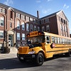BRYAN EATON/Staff photo. School buses pull up to the Page School in West Newbury which had been closed since early January with students attending other Pentucket District schools.