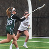 BRYAN EATON/Staff photo. Pentucket's Clara Dore moves the ball past Newburyport's Margaret Cote.