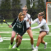BRYAN EATON/Staff photo. Pentucket's Anna Wyner gets pressure from Newburyport's Callie Beauparlant and Maggie Pons.
