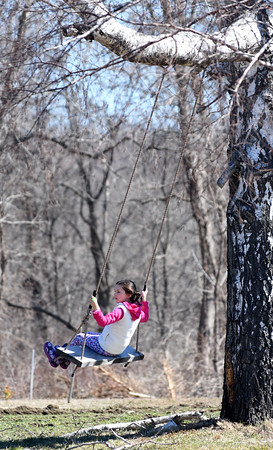 JIM VAIKNORAS/Staff photo Annabel Ziev, 6, takes a break on the swing during an egg hunt at the Bradstreet Farm in Rowley. The event venue which recently opened, brought back the egg hunt which for years was put on by the Bradstreet family.
