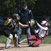 JIM VAIKNORAS/Staff photo Newburyport's Annie Siemasko is tagged out sliding into home against North Reading Friday at Pioneer park in Newburyport.