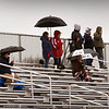 BRYAN EATON/Staff photo. Umbrellas were in force at Triton High School on Tuesday as the boys lacrosse team hosted Wakefield. Rain continues today, though the temperature is to go over 60 degrees.