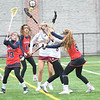 JIM VAIKNORAS/Staff photo Newburyport's Molly Rose Kearney (6) and Callie Beauparlant (8) fight for the ball against Central Catholic's Cali Mikson (130 and Caroline Pinho (5) at Newburyport Thursday.