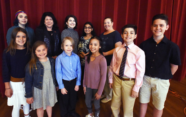 BRYAN EATON/Staff photo. Newburyport Mayor Donna Holaday is flanked by the Peace Prize Award recipients presented by the city's Human Rights Commission on Monday night. Front, from left, Courtney Metzdorf, Avery Tierney, Lucas Palen, Ella Treitel Poor, Mark Mosesian and Samuel Walker. Back, from left, Maggie Diely-Swearingen, Holaday, Julia Tiernan, Riya Kauer, Andrea Egmon, with Maya Battis-Wyatt, missing from photo, and Lindamae Lucas awarded postumously. Emily Webber's fourth grade class from the Molin Upper Elementary School was named Peace Prize winners as well, in online photo.