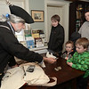 CARL RUSSO/staff photo. Mike Welch of West Newbury, a Patriot soldier from the Glover's Marblehead Regiment talks to Kristen Packer of Seabrook and her sons, from left, Sam Merrill, 12, Jack Merrill, 3and Charlie Merrill, 5. In honor of Patriots' Day, the Museum of Old Newbury in Newburyport had two historical re-enactors representing the Revolutionary war and the Civil War visit the museum Monday. Mike Welch of West Newbury, a soldier from the Glover's Marblehead Regiment talked about colonial life. Todd McGrath of Amesbury, a member of the Sons of Union Veterans of Civil War, Camp 60 in Salem N.H. talked about life as a Union soldier. 4/16/2018