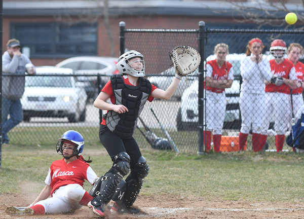 JIM VAIKNORAS/Staff photo Amesbury's Hannaih Burdick waits for the throw as Mascomonet's Sophia Chicorelli slides into home plate  at Amesbury Mille School Friday.