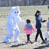 JIM VAIKNORAS/Staff photo The Easter Bunny greets kids during an egg hunt at the Bradstreet Farm in Rowley. The event venue which recently opened, brought back the egg hunt which for years was put on by the Bradstreet family.
