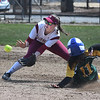 JIM VAIKNORAS/Staff photo Newburyport's Megan Winn waits for a throw as a North Reading player steals second against North Reading Friday at Pioneer park in Newburyport.
