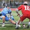 BRYAN EATON/Staff photo. Triton's #20 tries to scoop the ball.