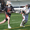 BRYAN EATON/Staff photo. Newburyport's Matt Donlan heads off Ipswich player #26.