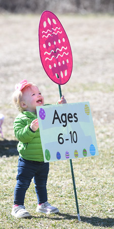 JIM VAIKNORAS/Staff photo Violet Rose More, 1, checks out a sign during an egg hunt at the Bradstreet Farm in Rowley. The event venue which recently opened, brought back the egg hunt which for years was put on by the Bradstreet family.