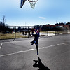 """BRYAN EATON/Staff photo. Nate O'Donnell, 10, lays up a shot during YWCA afterschool activities at the Bresnahan School on Monday afternoon. He's a fan of Boston sports in general but says he """"loves the Celtics."""""""