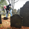 BRYAN EATON/Staff photo. Jack Piotrowski, 12, pictured, and other seventh-graders from the Nock Middle School in Newburyport, straightened out gravestones at the Old Hill Burying Ground on Thursday under the guidance of historian Ghlee Woodworth. They also did the same at the nearby Highland Cemetery and cleaned up downed branches and other debris from the March storms. The project is part of their volunteering for the community.