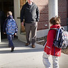 BRYAN EATON/Staff photo. Page School Principal Dustin Gray greets students as they return to school on Monday morning. The West Newbury school had been closed since January 2 when a pipe burst flooding the school and exposing other problems that needed to be corrected.
