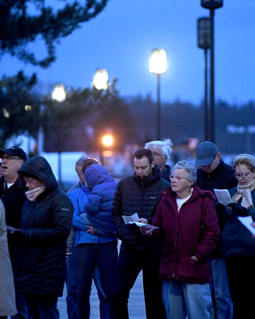 JIM VAIKNORAS/Staff photo Parishioners from the Old South Church gather  Sunday morning near the Heather Lynn II memorial on the board walk in Newburyport, for an Easter Sunrise service.