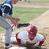 JIM VAIKNORAS/Staff photo Masconomet's Jack Seymour gets back to first just under the glove of Triton's Travis Madden at Masconomet Tuesday.