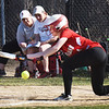BRYAN EATON/Staff photo. Amesbury's #4 tries a bunt.