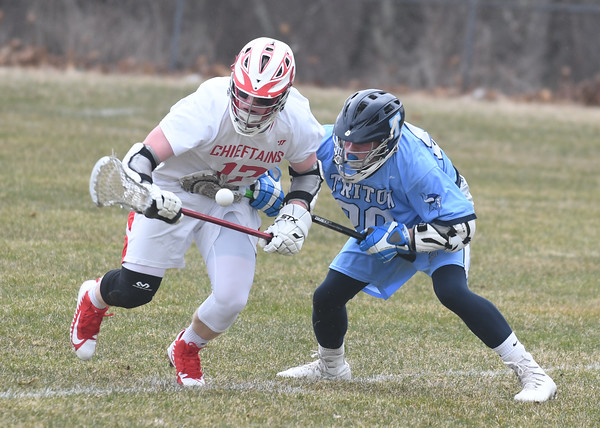 JIM VAIKNORAS/Staff photo Triton's Ben Fougere fights for the ball with Masco's Jay Therault during their game at Masco Tuesday.