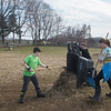 JIM VAIKNORAS/Staff photo Ethan Klucznic, 10, Clay Erickson, 9, and Addy Shoneman, 12, put out hay at the Spencer Pierce Little Farm in Newbury Friday morning. They were part of a group of about 50 students from grades 4, 5, and 6 from the River Valley Charter School in Newburyport who came out to the farm on Community Service Day.