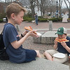 JIM VAIKNORAS/Staff photo Conner Demann, 12, and Sam Hartford, 10, enjoy pizza at a warm Friday afternoon on Inn Street in Newburyport. The boys are students at the River Valley Charter School.