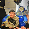 "BRYAN EATON/Staff photo. Lifelong Newburyport resident Melvin Russell smiles as staff and fellow clients at Opportunity Works sing ""Happy Birthday"" for his 80th on Monday. Until several years ago he was often seen in downtown Newburyport greeting everybody with a smile and a ""hi buddy"" while picking up cans and bottles to recycle but also picking up and disposing of litter. He is the longest client still at the facility and works two hours a week in a job involving recyling and received recognition from Newburyport Mayor Donna Holaday and state Rep. Jim Kelcourse who both attended Monday."