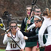 BRYAN EATON/Staff photo. Newburyport's Margaret Cote looks to pass to Kathleen Geary.