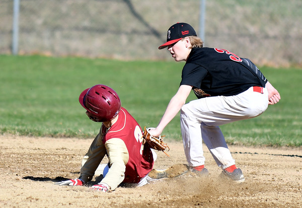 JIM VAIKNORAS/Staff photo Amesbury's Derrek Doughty gets the tag down as Newburyport's Ken Hodge is out stealing second at Newburyport Tuesday.