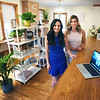 BRYAN EATON/Staff photo. TopKnots, a women's collaborative workspace in downtown Newburyport, owned by Callie Hefferan, left, and Sarah Lord opened yesterday.