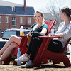 BRYAN EATON/Staff photo. Timing is everything as Carlie Schena, left, and Amber Wollinger, both of Newburyport, enjoy Tuesday's nice weather on the Newburyport Waterfront, both having to work today with rain in the forecast. The sun breaks again for the weekend with warm temperatures.
