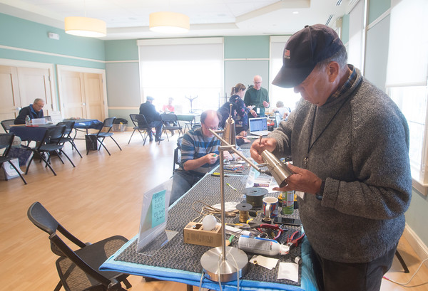 JIM VAIKNORAS/Staff photo Will Buddenhagen fixes a lamp during the Repair Cafe at the Senior Center in Newburyport Saturday. Local experts were on hand to fix broken items free of charge through out the day. Among the item repaired were wooden chairs, baskets, clothing, electronics, and appliances.
