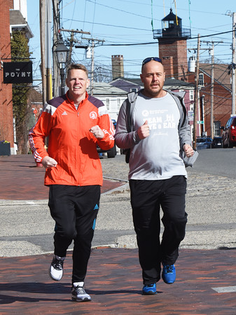 BRYAN EATON/Staff photo. Jason Field, right, and his friend Alex Forrest-Hay are running in the Boston Marathon to raise money for Mass Eye and Ear.