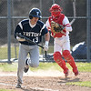 JIM VAIKNORAS/Staff photo Masconomet's Pat Costigan throws out Triton's Dylan Shute on a dropped third strike during their game at Masconomet Tuesday.