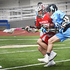 BRYAN EATON/Staff photo. Triton's #20 clashes with a player as they go for a loose ball.