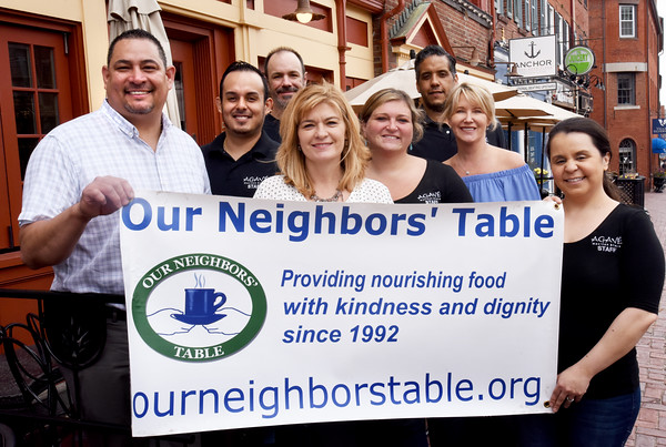BRYAN EATON/Staff photo. The second annual Fill Your Neighbors' Plate campaign sponsored by Our Neighbor's Table netted $5,000 in partnership with a dozen local restaurants. Employees of Agave and co-owner of the Grog pose, from left, Marco Maldanado, Edgar Castro, Bill Nichelmann (Grog), Kim Curran, Tracy DeBoisbriand, Jason Mosley, owner Dawn McCandless and Priscilla Feddersen.