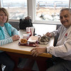 JIM VAIKNORAS/Staff photo Eileen and Joe Spero, of Haverhill enjoy scallops and steamers at Brown's Lobster Pound in Seabrook Friday. The popular eatery had a soft opening after it was damaged in a fire last summer.