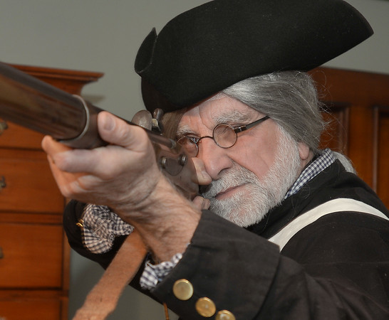 CARL RUSSO/staff photo. Mike Welch of West Newbury, a Patriot soldier from the Glover's Marblehead Regiment aims his musket. In honor of Patriots' Day, the Museum of Old Newbury in Newburyport had two historical re-enactors representing the Revolutionary war and the Civil War visit the museum Monday. Mike Welch of West Newbury, a soldier from the Glover's Marblehead Regiment talked about colonial life. Todd McGrath of Amesbury, a member of the Sons of Union Veterans of Civil War, Camp 60 in Salem N.H. talked about life as a Union soldier. 4/16/2018