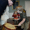 CARL RUSSO/staff photo. Anderson Teel, 4, bangs Todd McGrath's Civil war drum as his brother, Harrison, 14 months watches. They were visiting the Museum with their father Jonathan Teel of Newburyport. In honor of Patriots' Day, the Museum of Old Newbury in Newburyport had two historical re-enactors representing the Revolutionary war and the Civil War visit the museum Monday. Mike Welch of West Newbury, a soldier from the Glover's Marblehead Regiment talked about colonial life. Todd McGrath of Amesbury, a member of the Sons of Union Veterans of Civil War, Camp 60 in Salem N.H. talked about life as a Union soldier. 4/16/2018