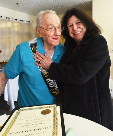 BRYAN EATON/Staff photo. Newburyport Mayor Donna Holaday poses with William Dziadosz who turned 100 yesterday as she gave him a commendation and a kiss at the Country Center for Health and Rehabilition. The party was also for the facility, formerly knows as Country Manor, which celebrated its 50th anniversary.