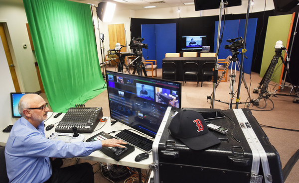 BRYAN EATON/Staff photo. Lance Wisniewski of Salisbury Community TV in their new studio behind Millenium Engineering on Elm Street. The studio is temporary as they will move into the old Salisbury Memorial School, which houses the Boys and Girls Club, is renovated.