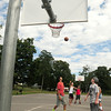 BRYAN EATON/ Staff Photo. Teens play a game of pickup basketball at Amesbury Town Park on Thursday and will be heading back to school on Tuesday.