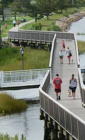 BRYAN EATON/ Staff Photo. There was a lot of foot traffic on the Newburyport Harborwalk leading to Cashman Park on Tuesday afternoon. There shouldn't be too many people there today as a couple inches of rain are expected in some areas.